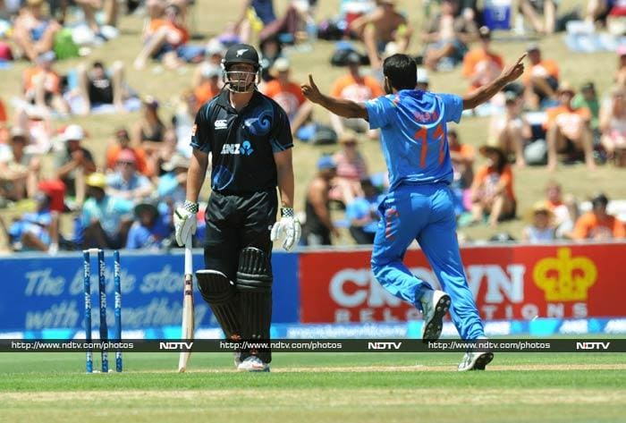 India won the toss and chose to field first, a decision that pleased even Kiwi skipper Brendon McCullum who said he would have batted first anyway. <br><br>Mohammad Shami (right) gave India a solid start when he removed opener Jesse Ryder.