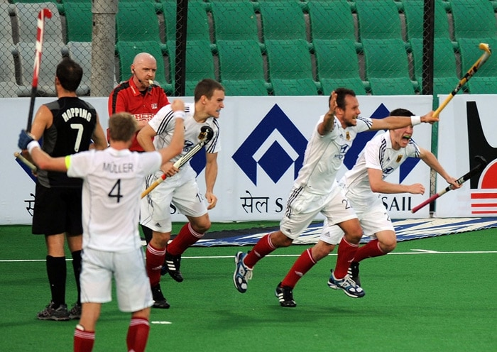 German hockey player Matthias Witthaus (2R) reacts after scoring Germany's fifth goal against New Zealand during their World Cup 2010 match at the Major Dhyan Chand Stadium in New Delhi. (AFP Photo)