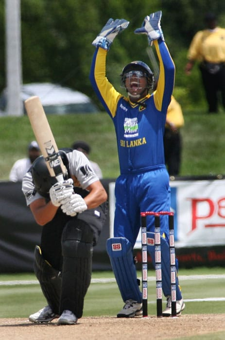 Sri Lanka's wicketkeeper Kumar Sangakkara reacts as New Zealand Striker Rob Nicolis is LBW. Nicolis was dismissed for a duck as New Zealand scored 81 in their 20 overs. (AP PHOTO)