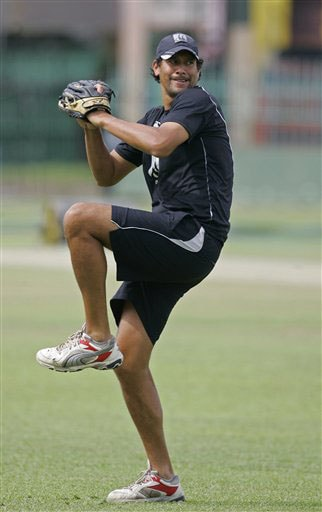 New Zealand's Jacob Oram throws a base ball during a practice session ahead of the triangular series in Colombo. (AP Photo)