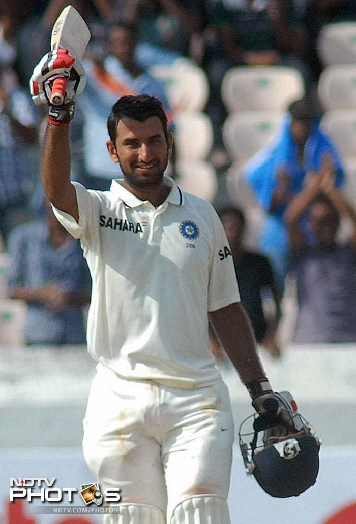 Cheteshwar Pujara was included in the side and he thanked all for the chance by slamming his maiden Test century, against New Zealand. India took 307/5 from the day's play. (AFP images)