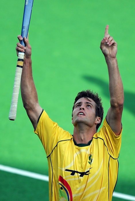 South African hockey player Lloyd Norris-Jones reacts after scoring a goal against New Zealand during their World Cup 2010 classification match at the Major Dhyan Chand Stadium. South Africa and New Zealand are tied 4-4 till extra-time. (AFP Photo)