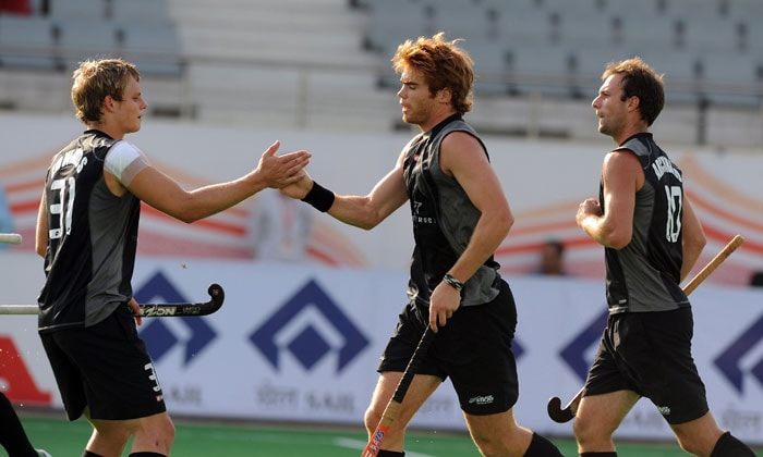 New Zealand hockey player Andy Hayward (C) celebrates a goal against South Africa with teammates during their World Cup 2010 classification match for 9th and 10th place at the Major Dhyan Chand Stadium in New Delhi on March 12, 2010. New Zealand and South Africa are tied at 4-4 till extra time. (AFP Photo)