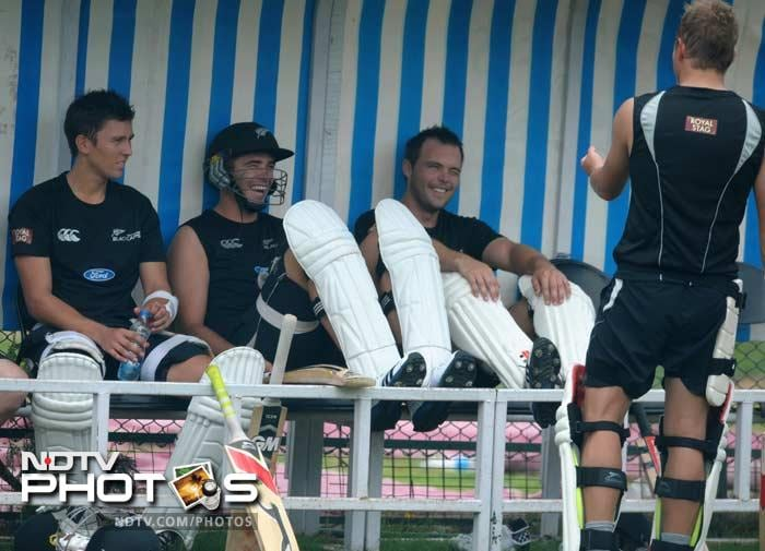 Doug Bracewell (L), Tim Southee (C), and James Franklin (2R) share a joke as they wait for their turn to bat.