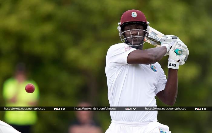 By the the close of the fourth day he was sharing an unbroken 80-run stand with captain Darren Sammy (in pic) on 44 and ensured New Zealand would have to bat again.