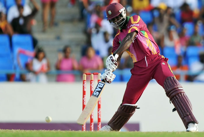 West Indies cricketer Darren Sammy hits a boundary during the second innings.Sammy remained not out on 58.(AFP PHOTO)