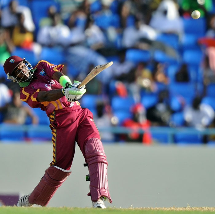 West Indies cricketer Dwayne Bravo hits a boundary off South African bowler Lonwabo Tsotsobe.Bravo top-scored with 74 runs as West Indies made 283 all out. (AFP PHOTO)