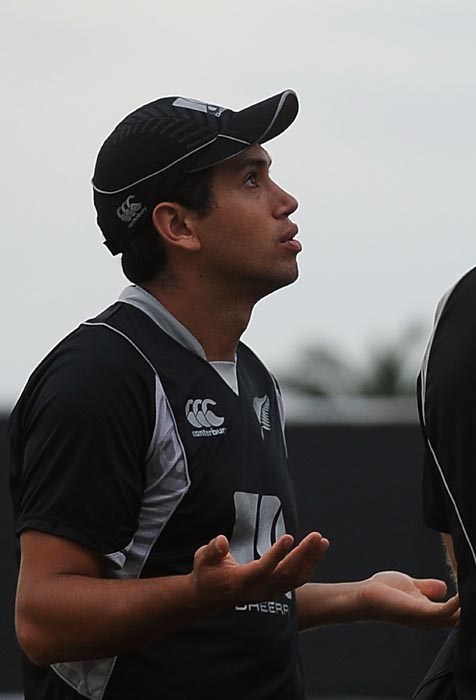 New Zealand cricket captain Ross Taylor gestures after play was stopped by rain during the fourth ODI between Sri Lanka and New Zealand at the Rangiri Dambulla International stadium in Dambulla. (AFP Photo)