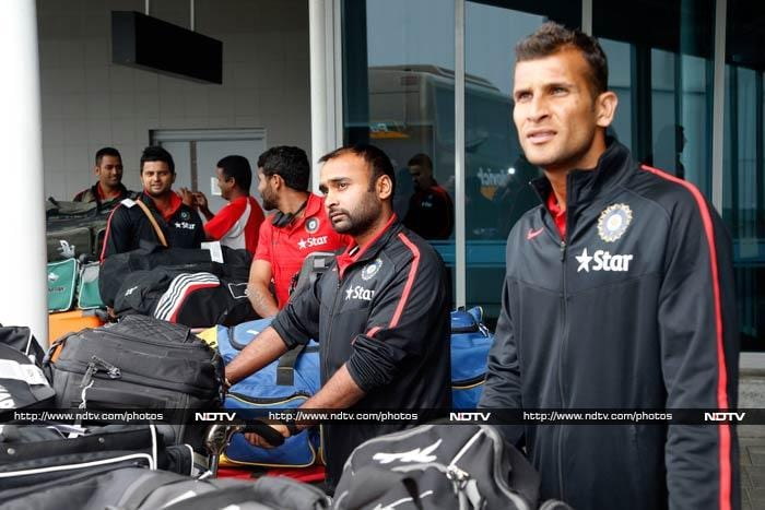 The cricketers wlak out into the parking, the jet lag pretty evident on thier faces.