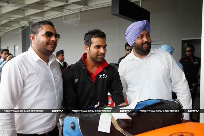 Rohit Sharma sports a smile as he poses with fans.
