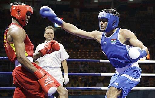Carlos Gongora of Ecuador, left, fights Vijender Kumar during a men's light middleweight 75 kilogram quarterfinal boxing match at the Beijing 2008 Olympics in Beijing. (AP)