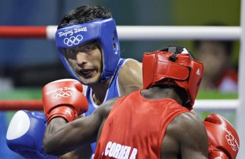 Emilio Correa Bayeaux of Cuba fights Vijender Kumar (blue) during a men's middleweight semifinal boxing match at the Beijing 2008 Olympics in Beijing. (AP)