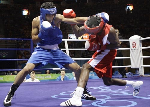 Vijender Kumar punches Emilio Correa Bayeaux of Cuba during a men's middleweight semifinal boxing match at the Beijing 2008 Olympics in Beijing. (AP)
