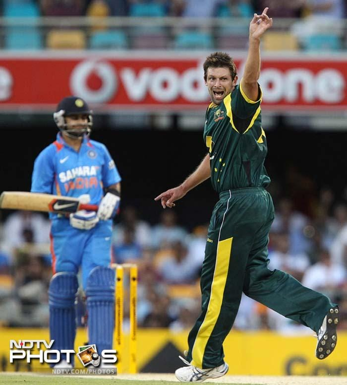 Australia's Ben Hilfenhaus, right, successfully appeals for the wicket of India's Virat Kohli during the one-day international cricket match between Australia and India in Brisbane.