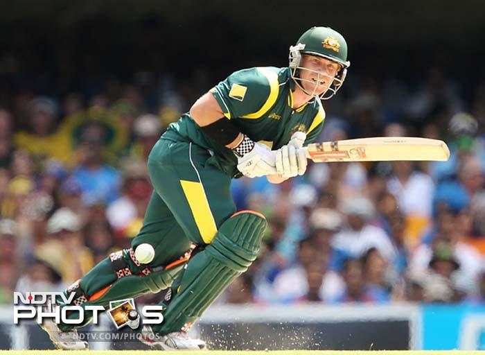 Australia's David Warner plays a shot during the One Day International cricket match between Australia and India in Brisbane.