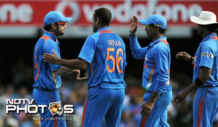 India's Virat Kohli (L) is congratulated by teammates after taking an outfield catch to dismiss Australian batsman Peter Forrest during their one-day international cricket match in Brisbane.