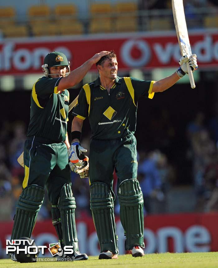 Australia's Michael Hussey (R) is congratulated by teammate Peter Forrest (L) after reaching his 50 during their one-day international cricket match against India in Brisbane.
