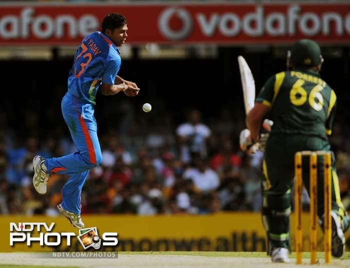Umesh Yadav of India (L) fails to take a catch off his own bowling after the ball was hit by Australia's Peter Forrest (R) during the one-day international cricket match against India in Brisbane.