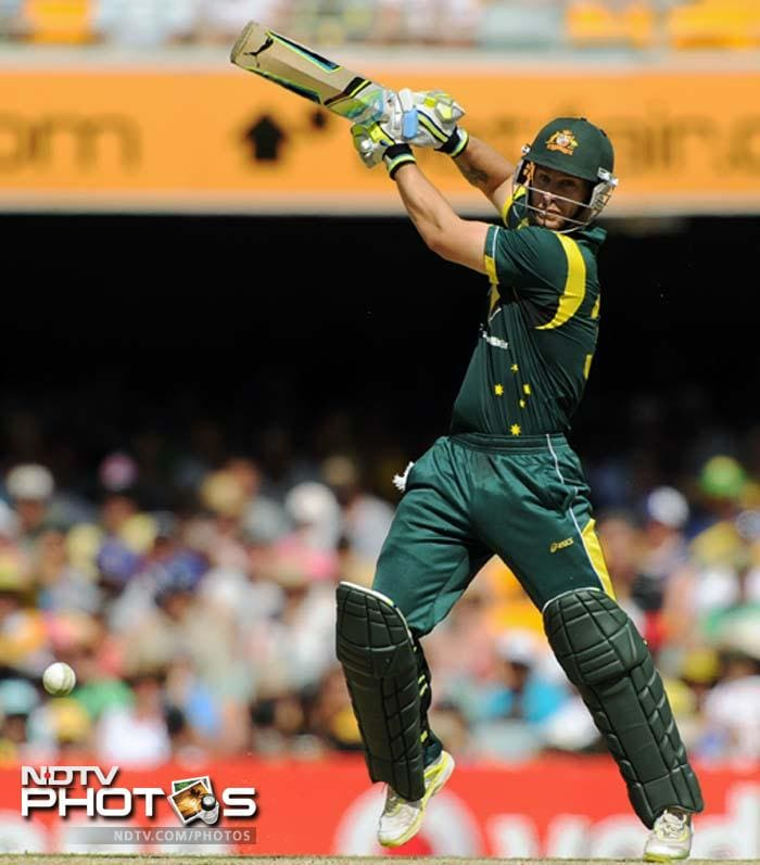 Australian batsman Matthew Wade plays the ball during the one-day international cricket match against India in Brisbane.