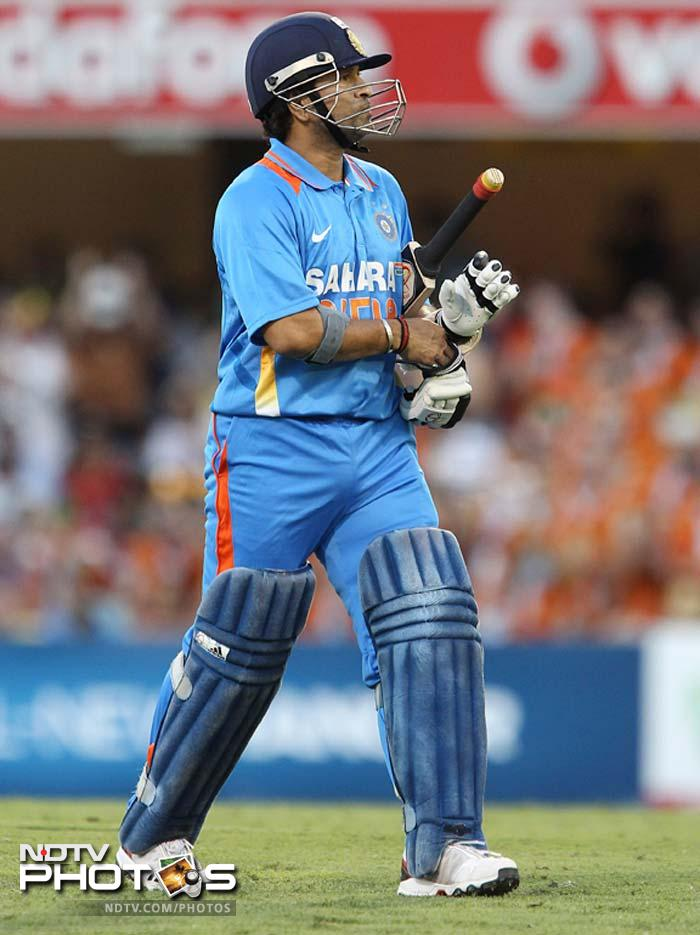 India's Sachin Tendulkar walks back to the dressing room after he lost his wicket for 3 runs during the One Day International cricket match between Australia and India in Brisbane.