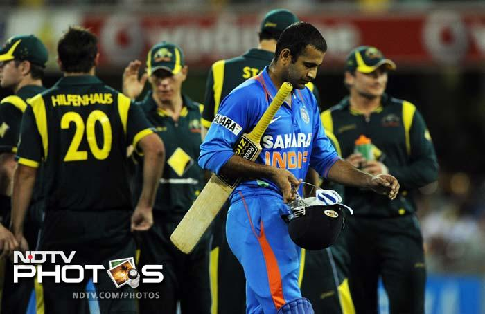 India's Irfan Pathan leaves the field after being dismissed during the one-day international cricket match against Australia in Brisbane.