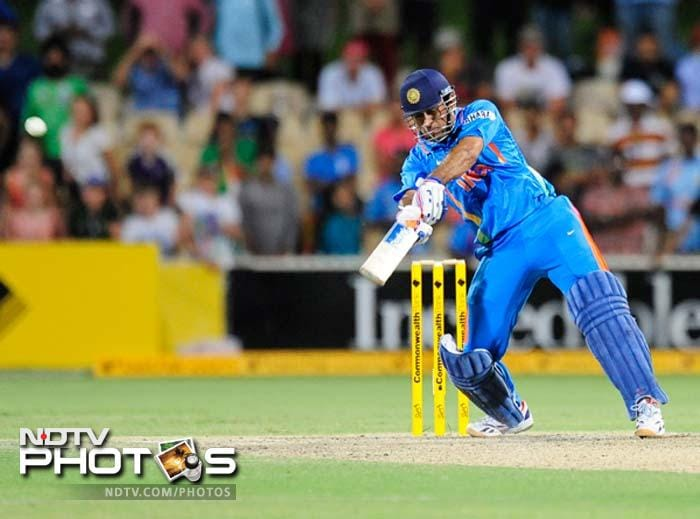 India's M.S. Dhoni bats against Australia during their one-day international cricket match in Brisbane.