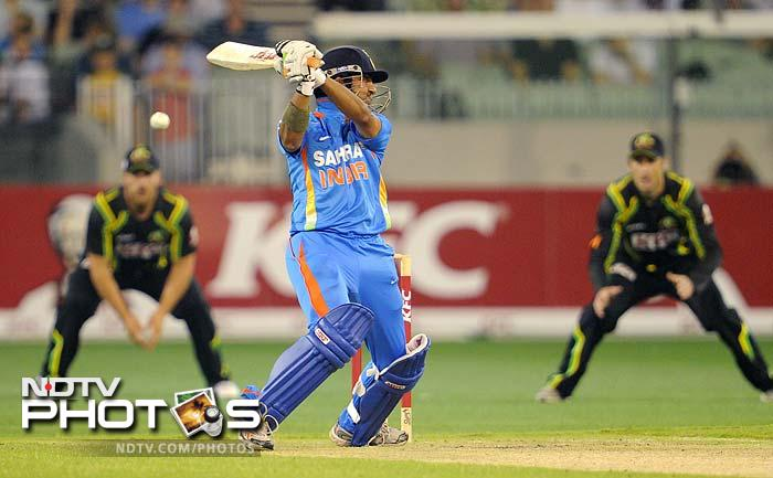 Indian batsman Gautam Gambhir (C) swings at a delivery in the international T20 cricket match at the MCG.