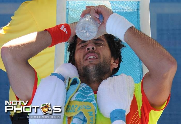 It's not just Team India feeling the heat Down Under. Players at Australian Open are feeling it too. Here Fernando Verdasco, who was sent packing by teenager Bernard Tomic in the opening round, tries hard to cool down.