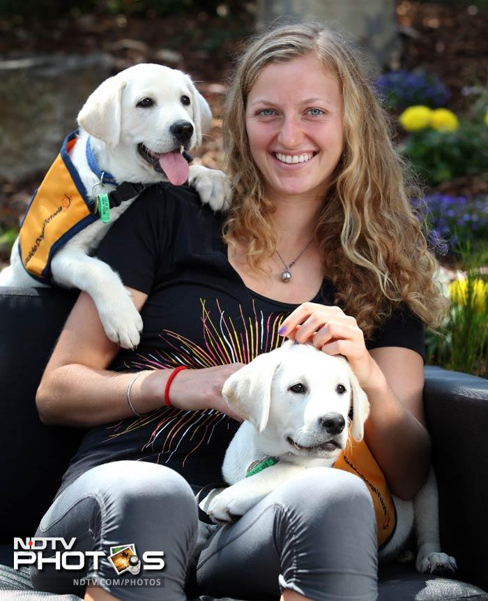 Wimbledon champion and World No. 2 Petra Kvitova shows some puppy love.