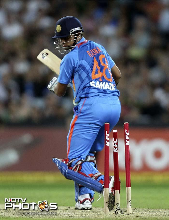 India's Suresh Raina looks back after he is bowled out during their Twenty20 International cricket match against Australia in Sydney.