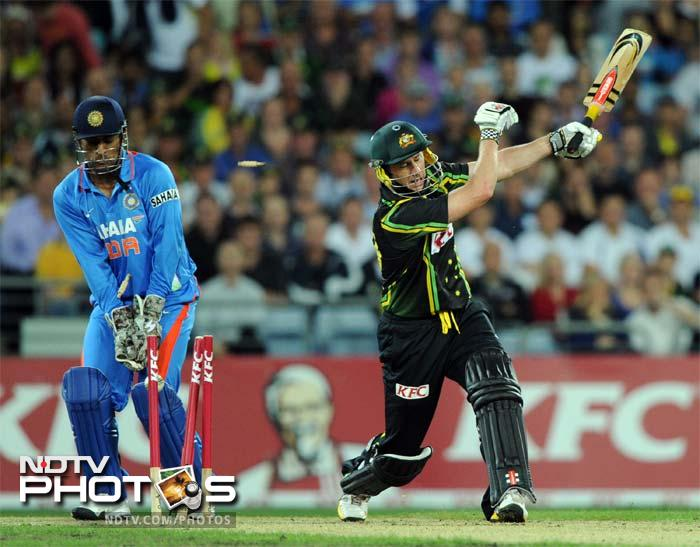 Australia's David Hussey (R) is bowled by India's Rahul Sharma during the Twenty20 cricket match in Sydney.