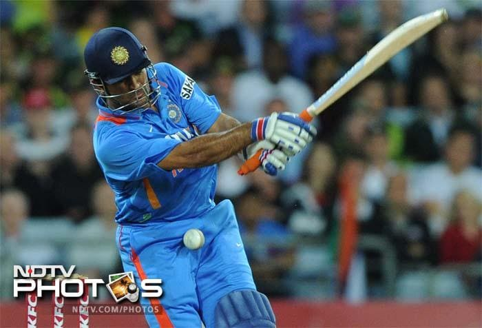 India's MS Dhoni is hit by a delivery during the Twenty20 cricket match against Australia in Sydney.