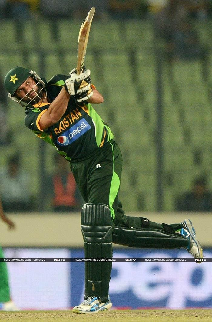 Shahid Afridi was declared man-of-the-match for his blinding heroics against Bangladesh - one that helped Pakistan chase down a record 327 and book a berth against Sri Lanka in final. <br><br>Here are some of the highlights from the thriller. (Images courtesy AFP and AP)