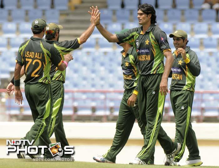 Pakistan won the toss and chose to field in the 5th ODI. <br><br>Mohammad Irfan is seen celebrating one of his two wickets. <br><br> Junaid Khan claimed three from the other end.