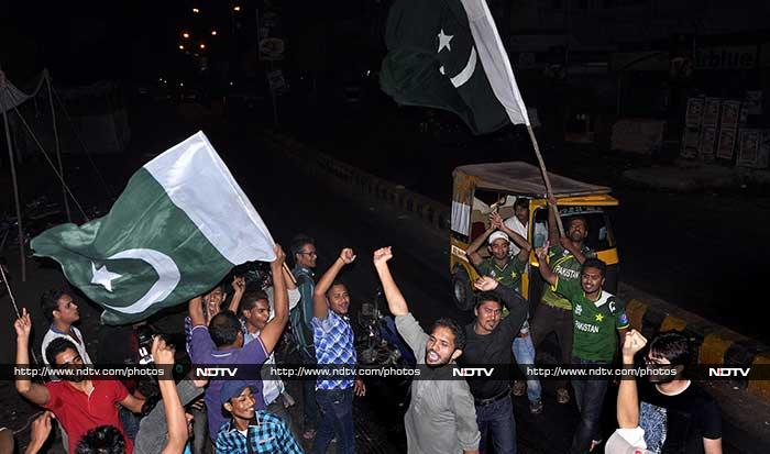Scenes in Karachi were like a carnival as defending champions Pakistan beat India by a wicket in what was a nail-biting thriller.