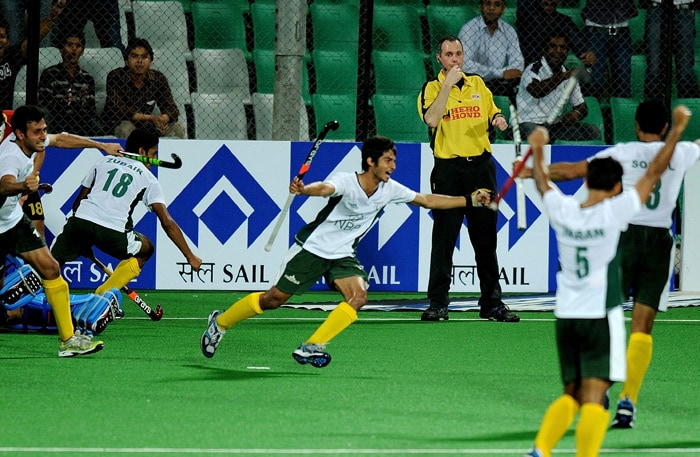 Pakistani hockey player Abdul Haseem Khan reacts after scoring his second goal against Spain during their World Cup 2010 match at the Major Dhyan Chand Stadium in New Delhi. (AFP Photo)