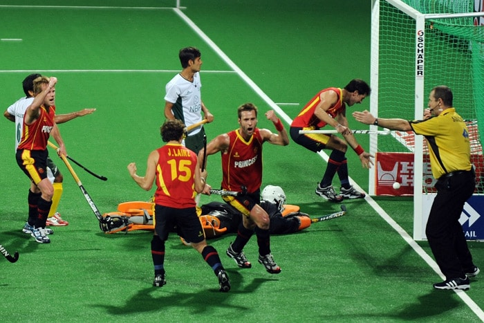Spanish hockey player David Alegre celebrates after scoring a goal against Pakistan during their World Cup 2010 match at the Major Dhyan Chand Stadium in New Delhi. (AFP Photo)