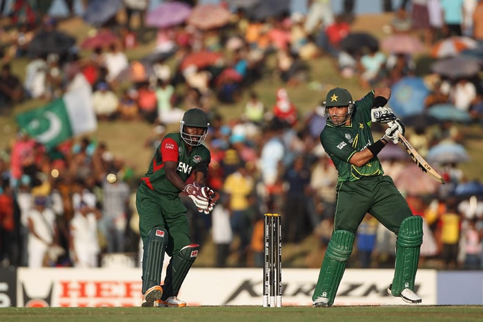 Misbah-ul-Haq (R) of Pakistan hits to the offside as wicketkeeper Morris Ouma (L) looks on during the Kenya vs Pakistan 2011 ICC World Cup Group A match at the Mahinda Rajapaksa International Cricket Stadium. (Getty Images)