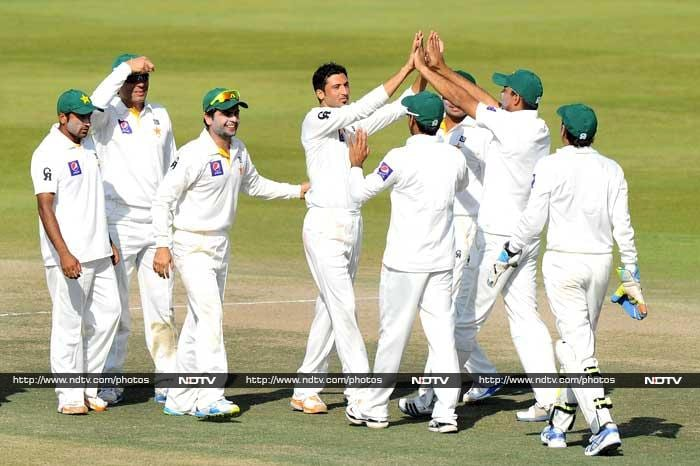 Junaid Khan (center) starred with the ball with a five-wicket haul as Sri Lanka were skittled out for 204 in the first innings after being asked to bat first at Abu Dhabi.