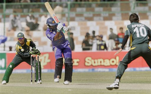 Chamara Kapugedera is bowled by Shahid Afridi as his teammate Kamran Akmal looks on during their first One-Day International at National Stadium in Karachi.