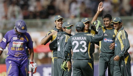Rao Iftikhar celebrates with teammates after taking the wicket of Kumar Sangakkara during their first One-Day International at National Stadium in Karachi.