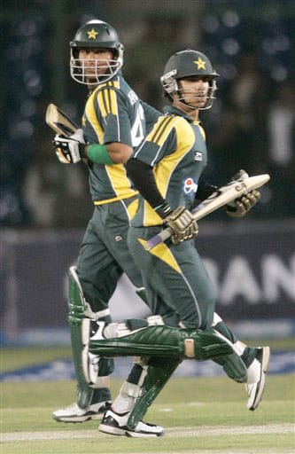 Salman Butt and Khurram Manzoor struggle for a run against Sri Lanka during their first One-Day International at National Stadium in Karachi.