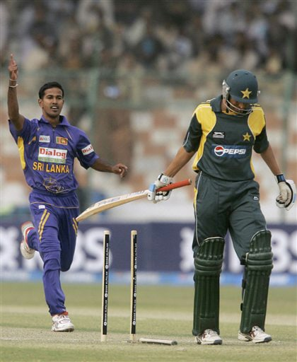 Younis Khan walks back after he is dismissed by Nuwan Kulasekera during their second ODI match at National Stadium in Karachi on Wednesday. (AP Photo)