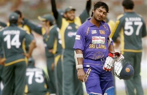 Kumar Sangakkara reacts after his dismissal against Pakistan during the second ODI match at National Stadium in Karachi on Wednesday. (AP Photo)