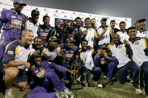 Sri Lankan players pose with winning trophy after won series and third one-day international cricket match against Pakistan at Gaddafi Stadium in Lahore on Saturday, January 24, 2009. Sri Lanka inflicted Pakistan's heaviest defeat in a limited-overs international, winning the final game by 234 runs to clinch the three-match series 2-1. (AP Photo)