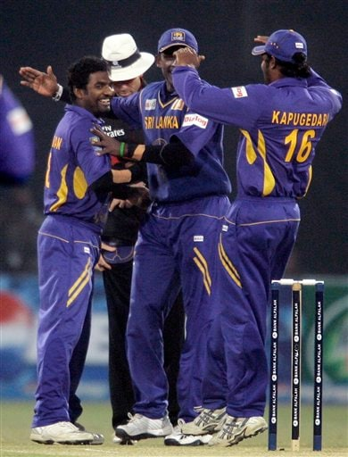 Muttiah Muralitharan is congratulated by teammates after taking his 500th wicket during the third one-day international cricket match against Pakistan at Gaddafi Stadium in Lahore on Saturday, January 24, 2009. Muralitharan became the only second bowler after former Pakistan quick Wasim Akram (502) to take 500 ODI wickets, finishing with 2-2. (AP Photo)