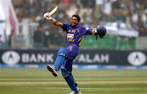 Sri Lankan batsman Tillakaratne Dilshan jubilates after complete his century against Pakistan during the third one-day international cricket match at Gaddafi Stadium in Lahore on Saturday, January 24, 2009. (AP Photo)