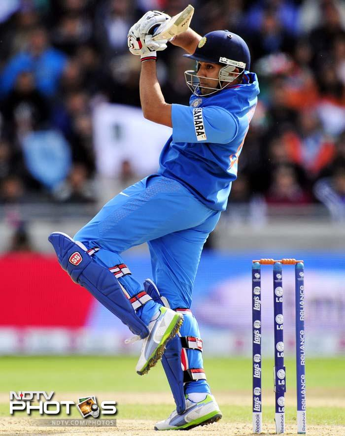 Rohit Sharma - the other opener - scored 18 before he fell to Saeed Ajmal.