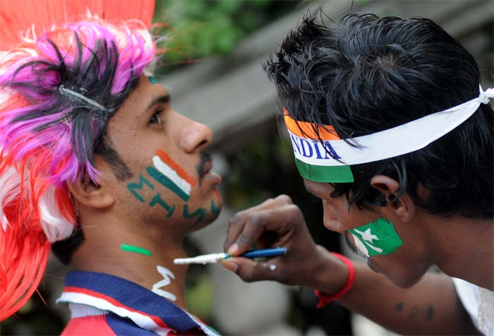 Fans paint their face with flags to show their support. (BCCI image)