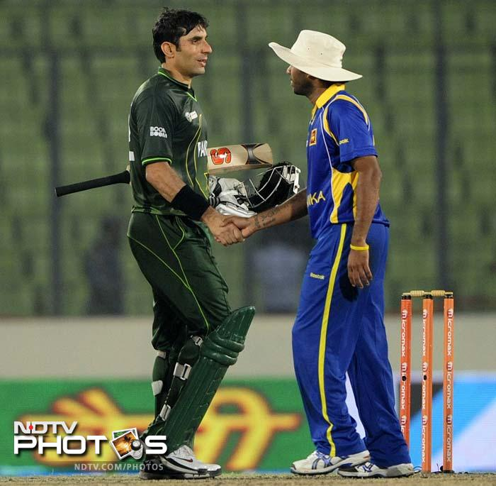 Farveez Maharoof eventually sent Akmal back but with four required, the Pakistani skipper (L) eased his team to a win with 10.1 overs to spare.